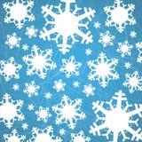 在冰与犁沟-圣诞节背景的雪花 免版税库存图片