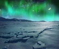 在冰冷的平原的极光北极星 库存照片
