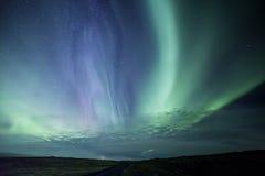 在冰岛熔岩荒野的极光 免版税库存图片