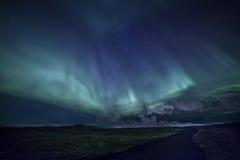 在冰岛熔岩荒野路的极光 免版税库存照片