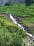在冰川国家公园的瀑布 免版税库存照片