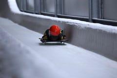 在冰渠道的最基本的突然移动雪撬 免版税库存照片