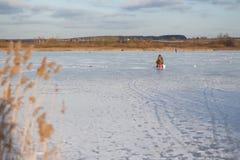 在冰的冬天捕鱼 图库摄影