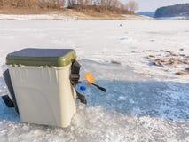 在冰的冬天捕鱼 免版税图库摄影