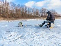 在冰的冬天捕鱼 库存照片
