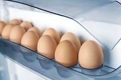 在冰箱架子的鸡蛋 免版税库存照片
