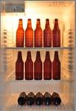 在冰箱的啤酒瓶 免版税图库摄影