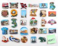 在冰箱的许多磁铁从国家 库存照片