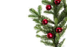 在冷杉大树枝的红色ornamentso 免版税库存图片