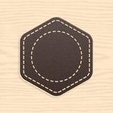 在减速火箭的葡萄酒样式的空白的皮革徽章 图库摄影