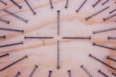 在几何构成照片的金属钉子 图库摄影