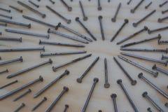 在几何构成照片的金属钉子 库存照片