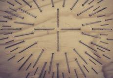 在几何构成照片的金属钉子 免版税库存照片