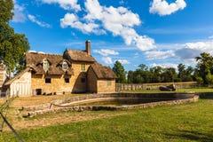 在凡尔赛宫殿附近的女王/王后的小村庄 库存图片