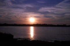 在出海口的日落 库存图片