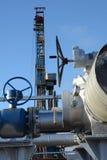 在凿岩机的背景的管子配件 库存图片