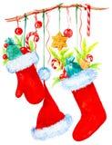 在分支垂悬圣诞老人项目盖帽和有红色起动的一个手套有很多甜点礼物  圣诞节水彩例证 库存例证