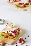 在切板的一个开胃沙拉三明治 免版税库存照片
