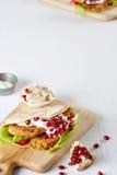 在切板的一个开胃沙拉三明治 库存图片