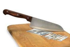 厨刀和被削减的票据 免版税库存照片