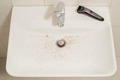 在刮脸以后的水槽 免版税库存照片