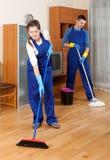 在制服的清洁队 免版税图库摄影