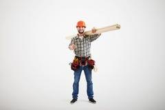 在制服的兴高采烈的建造者 免版税图库摄影