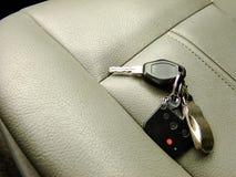 在前座的汽车钥匙 免版税库存图片