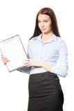 在剪贴板的女实业家愉快的微笑文字报名参加合同, 图库摄影