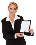 在剪贴板的女实业家文字 库存照片