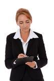在剪贴板的确信的女实业家文字 库存图片