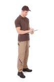 在剪贴板的年轻送货人文字 免版税库存图片