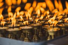 在加德满都寺庙的灼烧的黄油灯  库存图片