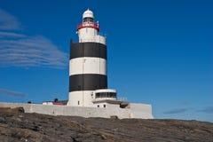 在勾子头,韦克斯福德,爱尔兰的勾子灯塔 免版税库存照片