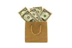 在包装纸袋子的美元钞票 库存照片