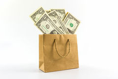 在包装纸袋子的美元钞票 免版税图库摄影