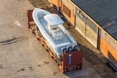 在包裹的快艇在船坞 图库摄影