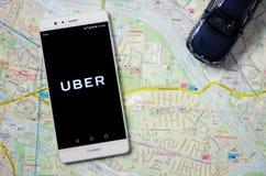 在华为P9的Uber商标 免版税库存图片