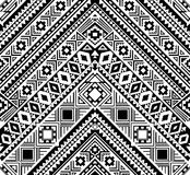 在单色,黑白颜色的无缝的种族样式 库存图片