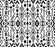 在单色,黑白颜色的无缝的种族样式 库存照片
