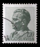在南斯拉夫打印的邮票显示法警约瑟普・布罗兹・铁托画象  图库摄影