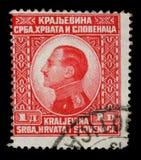 在南斯拉夫王国塞尔维亚,克罗地亚和斯洛文尼亚南斯拉夫的亚历山大一世国王展示打印的邮票画象  免版税库存照片