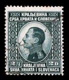 在南斯拉夫王国塞尔维亚,克罗地亚和斯洛文尼亚南斯拉夫的亚历山大一世国王展示打印的邮票画象  库存照片