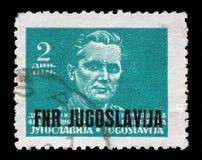 在南斯拉夫联邦民主共和国打印的邮票显示法警约瑟普・布罗兹・铁托 库存照片