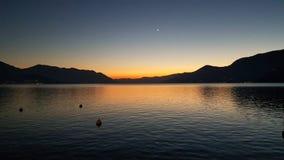 在卢加诺湖的日落 免版税库存图片
