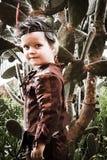 在印地安服装打扮的小男孩 免版税图库摄影