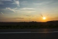 在卷云的日落 库存照片