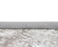 在卷灰色织品地毯的特写镜头表面抽象织品样式在房子在白色的纹理背景地板  库存照片