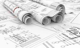 在卷的建筑图纸 免版税库存照片