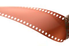 在卷被松开的白色的35mm影片 免版税库存照片